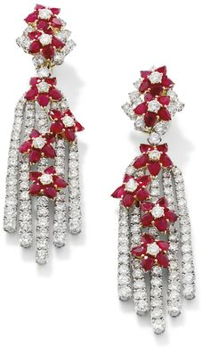A pair of diamond and ruby ear pendants, by Dianoor  Each designed as a tassel of five lines of brilliant-cut diamonds to applied pear-shape ruby and brilliant-cut diamond flower clusters, detachable from the similarly cut ruby and diamond double flower cluster surmounts, length 9 cm, signed 'Dianoor', collapsable post and clip fittings, total diamond weight approximately 24.96 carats.