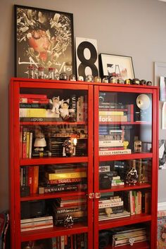 I love the idea of a slightly cluttered bookshelf with glass doors. I always love going through other peoples books to learn about them.