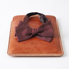 My iPad mini sleeve with a bow tie I inherited from the man that inspired me the brand (Mr. Timoleon) / Mi funda para iPad mini con una corbata de lazo de nada menos que Don Timoleon mismo, mi inspiración para la marca. #timogoods #leather #handmade #ipad