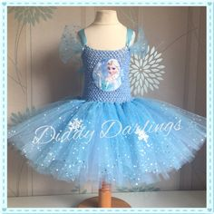 Elsa Tutu Dress. Frozen Tutu Dress. Sparkly.  Special Occasion.  Beautiful & lovingly handmade.  All characters and colours available Price varies on size, starting from £25.  Please message us for more info.  Find us on Facebook www.facebook.com/DiddyDarlings1 or our website www.diddydarlings.co.uk