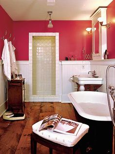 Shocking pink walls lend this bathroom a modern feel, while fixtures and vintage details give it a warmth and character found in old homes. (Photo: Photo: Sylvia Martin; Stylist: Lisa Allison)
