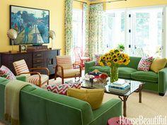 Green sofas in Rogers & Goffigon's Violetta cotton velvet.