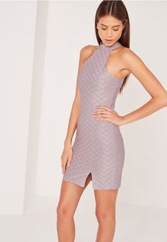 This purple split front high neck grid bodycon dress is totally amaze-balls and we can't get enough of it! The textured argyle, diamond grid pattern adds a sprinkling of luxe into this sexy mixture. With a split to the front, discrete zip...