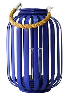 Nautically inspired and hand crafted from bamboo and rope, our Moana Bamboo Blue Lantern will bring an island feel to your home. This chic lantern will add a pretty glow to your patio, family room or bedroom.