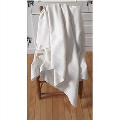 These antique loom woven wool blankets are cream-coloured, have a tight weave, and are in excellent condition. They have a centre seam made when looms were smaller and were woven in two panels and then hand sewn together to form a larger blanket. Found in Peterborough, Ontario, they are all in excellent condition with no holes, stains or worn areas. There are four blankets available. Dimensions vary slightly for two of them. See product details for more information. Sold individually. Circa…