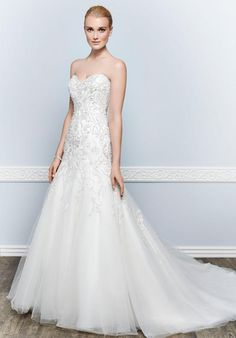Strrapless gown with mermaid silhouette, dropped waist style and semi-cathedral train length | Kenneth Winston | https://www.theknot.com/fashion/1654-kenneth-winston-wedding-dress