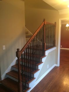 Before of the staircase with dark stained handrails, dark taupe walls