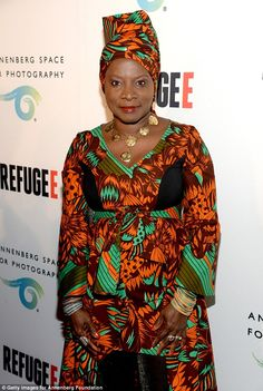 Pretty patterns: Musician Angelique Kidjo wore a bright orange and green African-patterned dress and matching head wrap