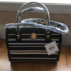 Anne Klein Handbag Gorgeous! With a pocket on each side!  Black & white stripes and gold detailing! Gorgeous bag with handles and a detachable cross body strap! 23'' Shoulder - Strap 10.5'' High - 11.75'' Wide Anne Klein Bags Satchels
