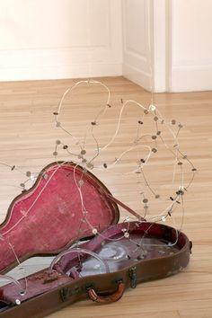 DAN COLEN Waiting on a Friend, 2013 Guitar case, wire and dime tangle 41 x 20 x 20 inches (104.1 x 50.8 x 50.8 cm)Dan Colen - Gagosian Gallery