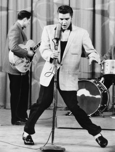 "Music during the included Elvis Presley, Little Richard, and Buddy Holly. All three of these music pioneers contributed to a new form of music called ""Rock n' Roll"" with Elvis being the most famous of these three. Beatles, Elvis Presley Pictures, Music Rock, El Rock And Roll, Photo Star, The Munsters, Munsters Tv Show, Teddy Boys, Priscilla Presley"