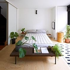 The bedroom has a minimalist feel. The throw is from Goodhood and the bench is by Ilse Crawford for Ikea