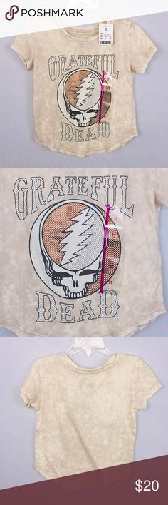 "Grateful Dead Skull Logo Kids 3T Tee-Shirt NWT Tag Size: 3T (New With Tags)  Chest - armpit to armpit, lying flat - 12.25""  Length - top of shoulder, at neckline to bottom of shirt - 15""  The Grateful Dead was an American rock band formed in 1965 in Palo Alto, California. The band is known for its eclectic style, which fused elements of rock, folk, country, bluegrass, blues, gospel, and psychedelic rock for live performances of lengthy instrumental jams, and for their devoted fan base, known as ""Deadheads"". Unbranded Shirts"