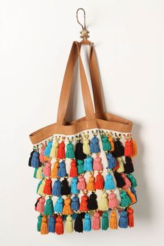 Wants to do a DIY version of this rather than spend $500 bones!! Canvas bag, thrifted leather trim, silken tassels from the fabric store.