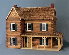 Real Good Toys Ponderosa Dollhouse Kit - 1 Inch Scale - Collector Dollhouse Kits at HayneedleThe magnificent Ponderosa Dollhouse features 12 spacious rooms and yet maintains a natural, rustic feel. Wooden shingles, log trim and siding and partial wra Cabin Dollhouse, Dollhouse Kits, Dollhouse Miniatures, Wooden Dollhouse, Cabin Homes, Log Homes, Tiny Homes, Real Good Toys, Popsicle Stick Houses