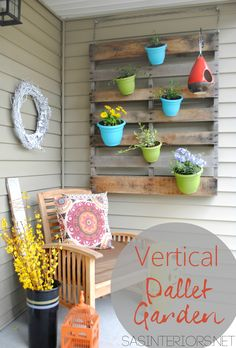DIY: Vertical Pallet Garden with Colorful Pots I could totally put one of those over-the-door towel organizers on my utility closet and hang plants from that.