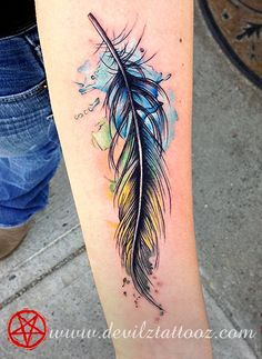 watercolor feather tattoo. Love this one for the dark black outlines that make it looks a little messy with the outside of the line colours, but the firm black lines make it strong.
