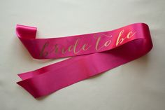 Bachelorette Sash - Gold on Pink by LePetitMariage on Etsy https://www.etsy.com/listing/166614998/bachelorette-sash-gold-on-pink