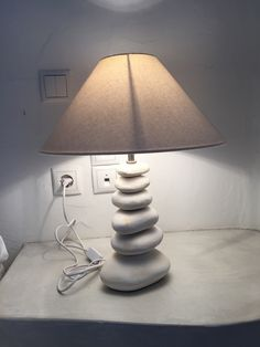 I have gathered each pebble one by one. Taken them to the electrician and made this lovely table lamp, in the Sea-Captain's suite in Oia Mansion in Oia village, Santorini island, Greece. www.oiamansion.com