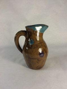 Ceramic Stoneware Pitcher with polka dots by KatieTroisi on Etsy https://www.etsy.com/listing/258806354/ceramic-stoneware-pitcher-with-polka