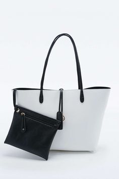 f8e0f03252a05 New Reversible Vegan Leather Tote in Ivory and Black Pouch
