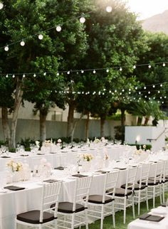 classic outdoor reception in Palm Springs | Photography by lanedittoe.com |  Floral Design by artisanevents.net |   Read more - http://www.stylemepretty.com/2013/07/23/palm-springs-wedding-at-the-viceroy-from-lane-dittoe/