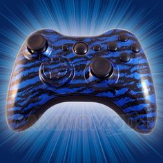 This is our Hydro Blue Tiger Modded Xbox 360 Controller. We have released our hydro dipped series of modded xbox 360 controllers and this model is one of the latest in that series. You can purchase this controller and many other custom Xbox 360 controllers exclusively at http://www.gamingmodz.com! Watch the video now: http://www.youtube.com/watch?v=8qTkzzyLRg8=share
