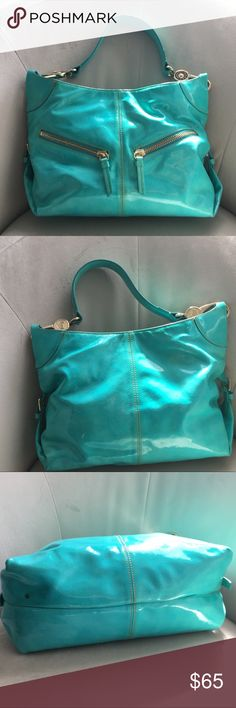 Dooney & Bourke Aqua patent leather handbag Dooney & Bourke handbag, GUC- inside is clean and stain free, outside has 3 small areas with dark marks (included in photos) I haven't tried to clean or replace the marks. No tears, holes. Perfect bag for the summer. Bags Hobos