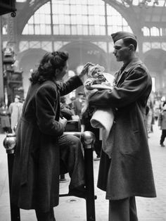 Wife and Baby Saying Farewell to Serviceman Husband and Father at Pennsylvania Station During WWII