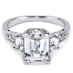 Tacori semi-mount in platinum (center stone not included) accommodates a 2.00 ct. emerald-cut diamond and has a knife-edge band with 0.50 ct. trapezoid-shaped side stones; $6,900 #Tacori #engagementring #diamond