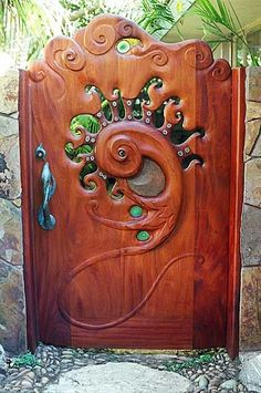 Whimsical gate door - would love to build this (or similar) for entrance to backyard (if I can do this affordably - looks like it would be an expensive high grade wood in order to replicate though) Cool Doors, The Doors, Unique Doors, Windows And Doors, Door Knockers, Door Knobs, Garden Gates, Garden Art, Garden Design