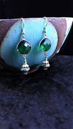 EMERALD CITY The color of the year has been Emerald.  Here are some glass earrings in Emerald with Vermeil and Jasper.  Perfect for those who love green and great for the holiday season, or all year long.  14 kt filled wires.     Price: $68.00 www.spitfiredesignsjewelry.com