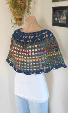 Hand crocheted in soft acrylic this capelet looks adorable over a tank or turtleneck with a pair of jeans.