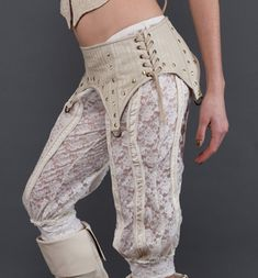 Could make a bellydance belt with a base something like this to connect to hidden straps on a skirt to hike it up. Miss Be Leather Garter Belt