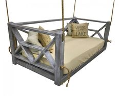small pallet with crib mattress and use scrap wood for fanciful sides
