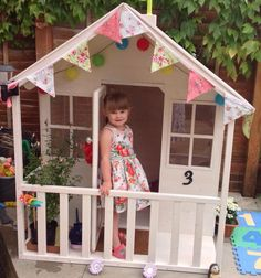 Wendy house built and decorated by my own fair hands.. Painted, adorned with door number, bunting, flowers, doormat and solar lights. She even has her own patio :)
