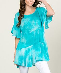 This Blue Tie-Dye Ruffle Dolman Tunic is perfect! #zulilyfinds I could do this with a t-shirt and add some extra fabric to the sleeves and waist.