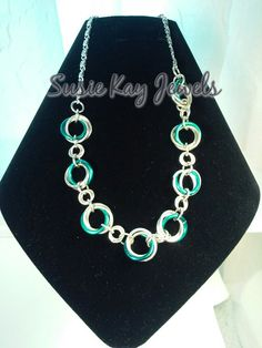Check out this item in my Etsy shop https://www.etsy.com/listing/221065688/chainmaille-3-in-2-swirl-pattern