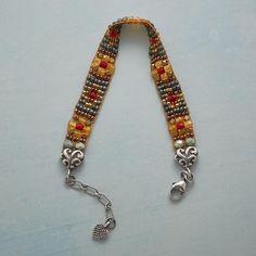 POPPY BEADED BRACELET:  simple beaded project w/ flower motif (seed beads?)