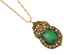 An century Indian emerald and diamond pendant Designed as a polished pear-shaped emerald bead mounted within a closed-set rose-cut diamond border with rose-cut diamond single stone detail and foliate surround, to a later neckchain Pendant Design, Pendant Set, Diamond Pendant, Bead Jewellery, Gold Jewelry, Queen, Rose Cut Diamond, Treasure Chest, Pear Shaped