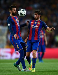 Gerard Pique (L) and Sergi Roberto of FC Barcelona in action during the UEFA Champions League Group C match between FC Barcelona and Celtic FC at Camp Nou on September 13, 2016 in Barcelona, Catalonia.