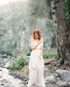 M O O D Surrounded by natures majestic trees and the quiet sounds of water running through streams. This is my happy place. A place where creativity is nurtured.  Featured on @magnoliarouge  Design & Styling @chloeandmint  Florals @emblemflowers  Gown @shopgossamer  Model @lauraclairegude  Ring @trumpetandhorn  Runner & Ribbon @silkandwillow  HMUA @chialimengartistry  Calligraphy @corsivocalligraphy  Veil @theveiledbeauty  Headpiece @naturae_design  @photovisionprints #romanceonfilm…