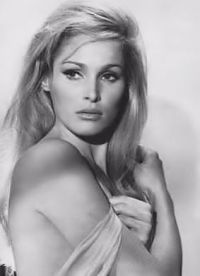 007 James Bond Girl 1962: Dr. No: Ursula Andress as Honey Ryder (Swiss actress iconic sultry voluptuous look sparked white Bikini craze; the 1st Bond Girl is still the hottest – unmatched ; )
