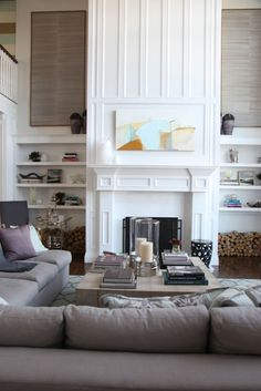 There are many elements in this I love:  the coffee table, artwork either side of the the fireplace, palette and bookshelf displays .... and the list goes on!