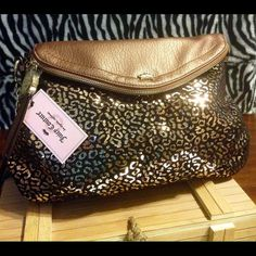 Brand new Copper Leopard Juicy bag. Couple of pockets on one side inside and a zippered pocket on the other. Zipper on flat opens up all the say to the bottom. Snap pocket on back of purse as well. Juicy Couture Bags Satchels