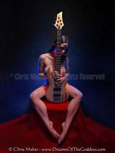 8861-LP.jpg - Colorful light outlines nude model Mila with her legs around her lovers ESP Bass Guitar.