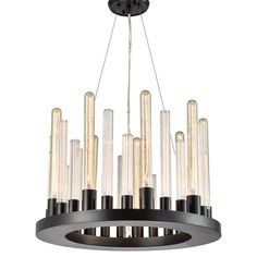 Evocative of a gleaming metropolis, the @elklightinginc #GlassSkyline series #Chandelier features a laser-cut Oil Rubbed Bronze ring foundation with oversized fluted rods that capture the light of our vintage-evocative tubular filament bulbs. #contemporaryconcepts #challengeconvention #atwhattogawk #EGI