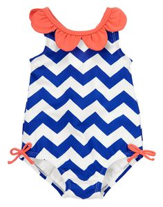 She takes to the water in fresh style in our on-trend chevron one piece. 3D petals trim the neckline for a sweet and girly look, while contrast color bows at the hips add an extra splash of cuteness.
