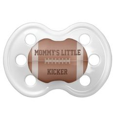 Mommys Little Kicker Babies Sports Football Ball Pacifiers This cute baby boy kids sport ball design features a football background with a template for personalizing with your babys name or your text. Great for the future baby kicker - punter of a football player, coach or fan. Mom will love this one!
