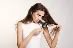 beautiful girl supprised and unhappy with her damaged and dry hair